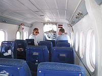 [Inside the plane]